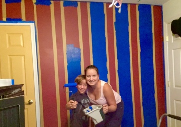 Jennifer and Spencer painting the stripes on that wall. FrogTape was the answer.
