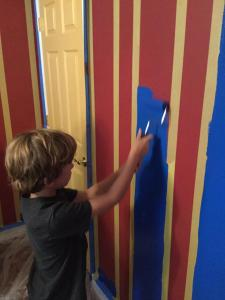 Spencer rolling out his dream wall.