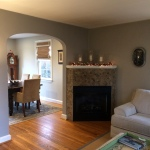 The rich, warm, earthy gray connects well with the fireplace, for a soft but not boring look for Maryann's living and dining rooms