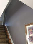 We chose a lighter warm gray for this entry and ahllway, but shifted to a deeper shade of gray - with a mysterious purple undertone for the stairway wall. Just the right amount of drama.